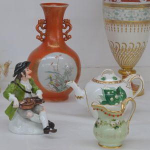 A small selection of ceramics from across the world: German Meissen figure, Irish Belleek pottery, Chinese Iron red, English Minton pate sur pate.